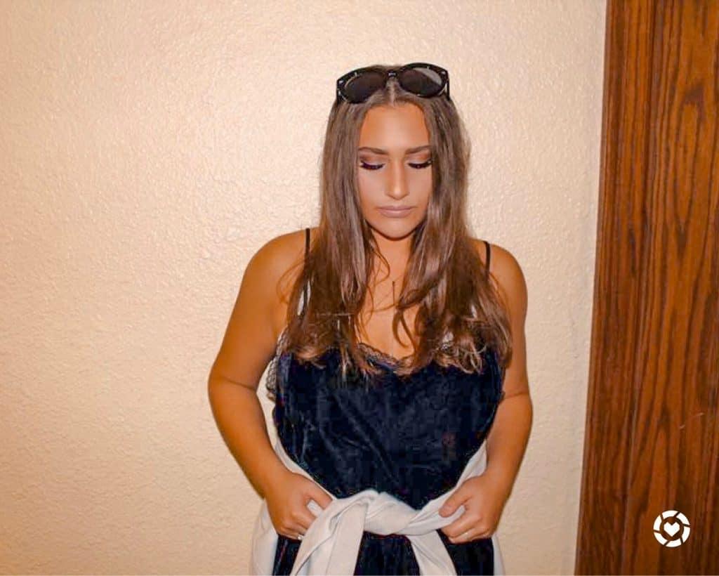 Jenna Haith with sunglasses and black dress