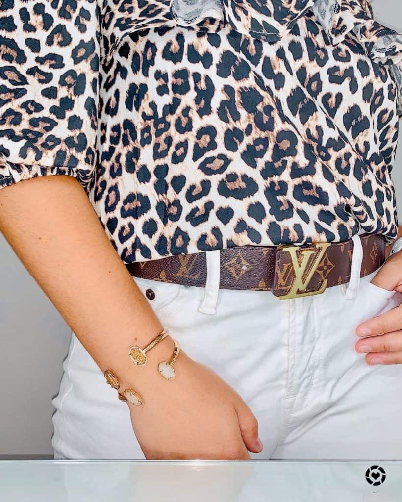 Louis Vuitton belt and cheetah shirt