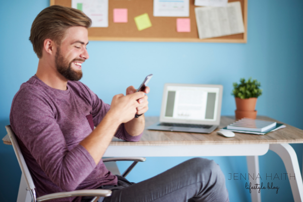man sitting at coffee shop on dating app